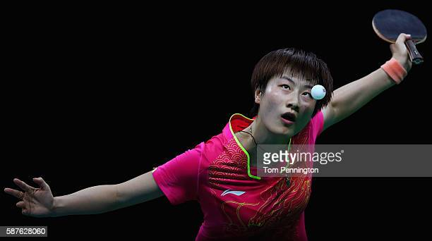 Ning Ding of China competes against Ying Han of Germany during the Women's Singles Quarterfinal 1 Table Tennis on Day 4 of the Rio 2016 Olympic Games...