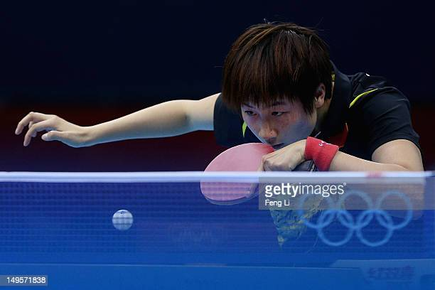 Ning Ding of China competes during the Women's Singles Table Tennis quarterfinal match against Ai Fukuhara of Japan on Day 4 of the London 2012...