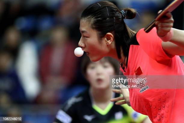 Ning Ding of China competes in the Women's Singles Round of 16 againt Saki Shibata of Japan during day two of the World Tour Grand Finals at Namdong...