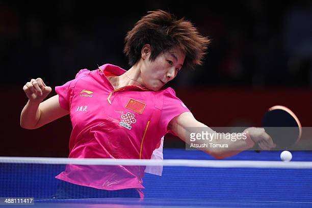 Ning Ding of China plays a forehand against Mengyu Yu of Singapore during day seven of the 2014 World Team Table Tennis Championships at Yoyogi...