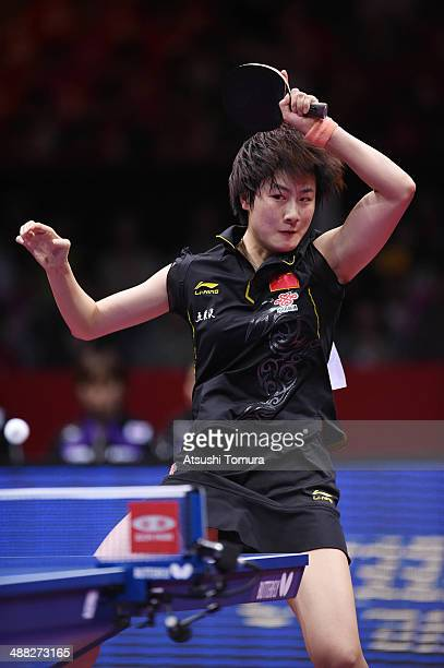 Ning Ding of China plays a forehand against Yuka Ishigaki of Japan during day eight of the 2014 World Team Table Tennis Championships at Yoyogi...