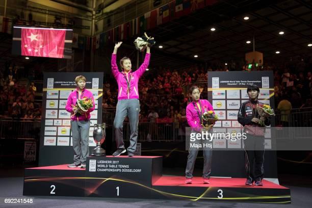Ning Ding of China poses with a gold medal next to Yuling Zhu of China Shiwen Liu of China and Miu Hirano of Japan during celebration ceremony of...