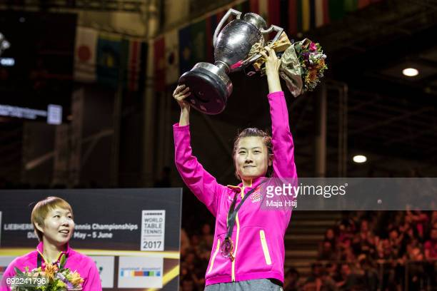 Ning Ding of China poses with a trophy next to Yuling Zhu of China during celebration ceremony of Women's Singles at Table Tennis World Championship...
