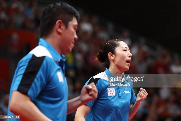 Ning Gao and Mengyu Yu of Singapore celebrate winning a point in the Mixed Doubles Gold Medal Match between Liam Pitchford and TinTin Ho of England...