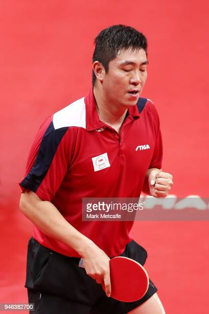 Ning Gao of Singapore celebrates winning a point in the Men's Singles Gold Medal Match against Quadri Aruna of Nigeria during Table Tennis on day 11...