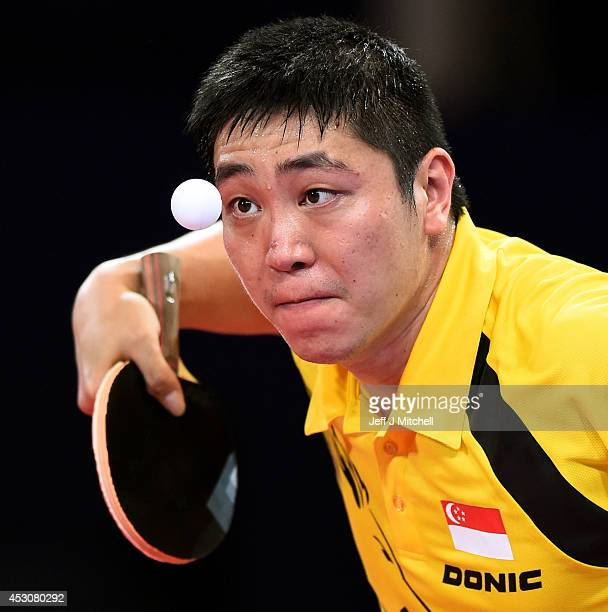 Ning Gao of Singapore competes against Jian Zhan of Singapore in the Men's Singles Gold Medal Match at Scotstoun Sports Campus during day ten of the...