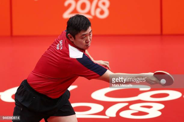 Ning Gao of Singapore plays a shot in the Men's Singles Gold Medal Match against Quadri Aruna of Nigeria during Table Tennis on day 11 of the Gold...