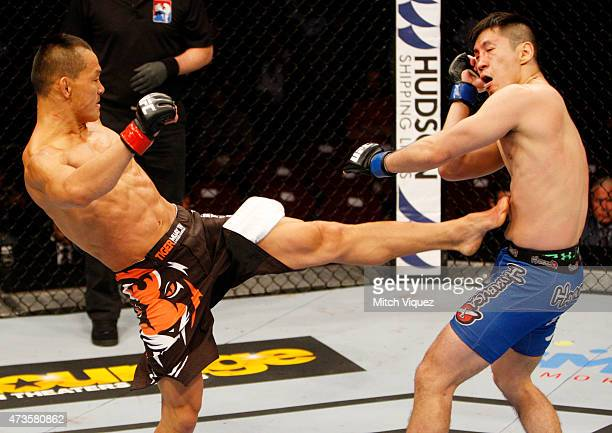 Ning Guangyou of China kicks Royston Wee of Singapore in their bantamweight fight during the UFC Fight Night event at the Mall of Asia Arena on May...