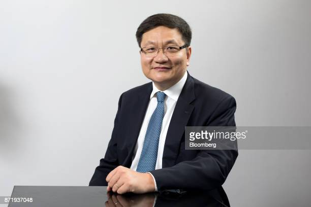 Ning Tang founder and chief executive officer of CreditEase Corp poses for a photograph following a Bloomberg Television interview at the AsiaPacific...