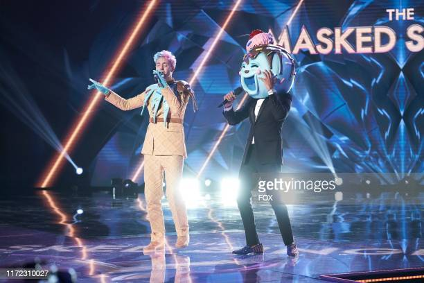 Ninja and host Nick Cannon in the Season Two Premiere episode of THE MASKED SINGER airing Wednesday Sept 25 on FOX