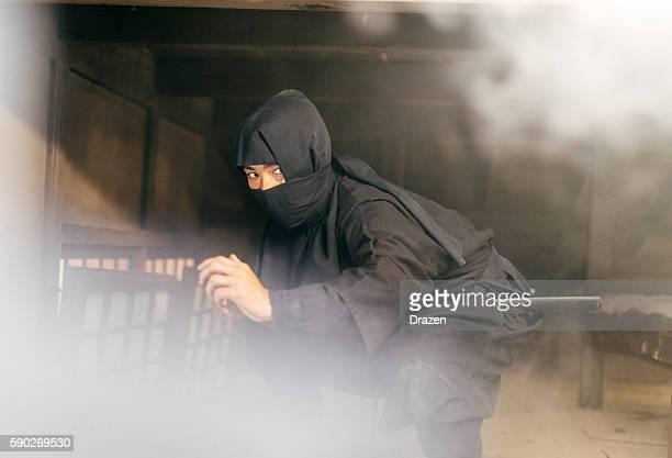 ninja hiding behind the smoke - ninja fotografías e imágenes de stock
