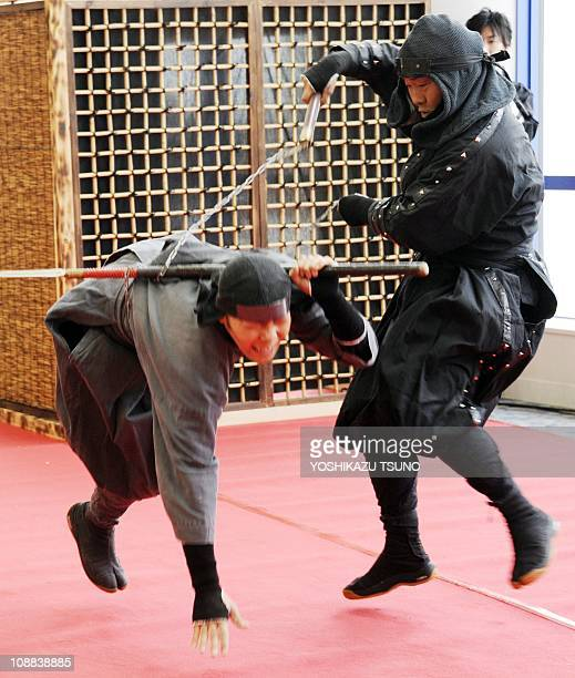 A 'ninja' master demonstrates his skills during a ninja festival at a shopping mall in Tokyo on February 5 2011 Some 80 people in ninja costumes from...