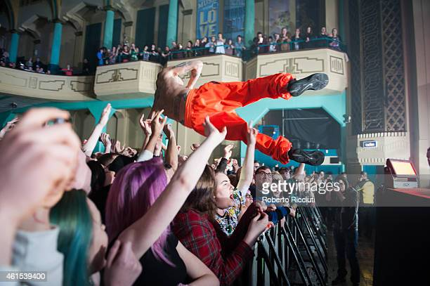 Ninja of Die Antwoord performs crowd surfing in the arms of the crowd on stage at O2 Academy on January 14 2015 in Glasgow United Kingdom