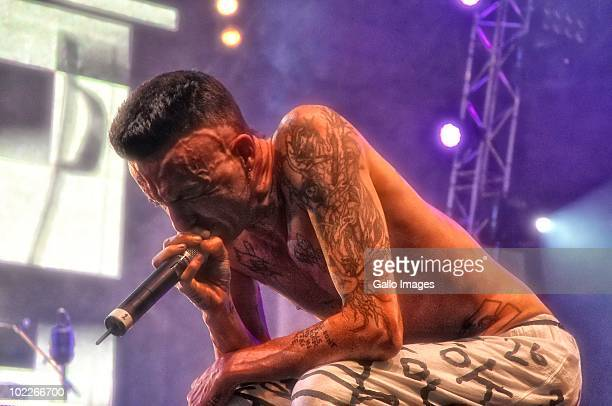 Ninja of South African band Die Anwoord performs at a concert held at the Cape Town Convention Centre , after Bafana's loss against Uruguay during...