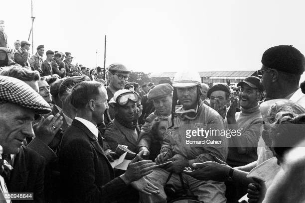 Nino Farina, Grand Prix of Great Britain, Silverstone Circuit, 18 July 1953. Nino Farina surrounded by fans and supporters at the finish of the 1953...