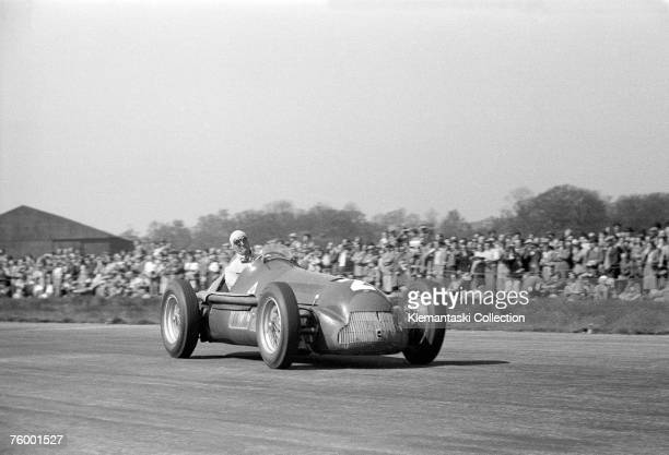 Nino Farina, putting on one of his patented faces of exertion, in his Alfa Romeo 159 during the British Grand Prix, Silverstone, 13th May 1950.