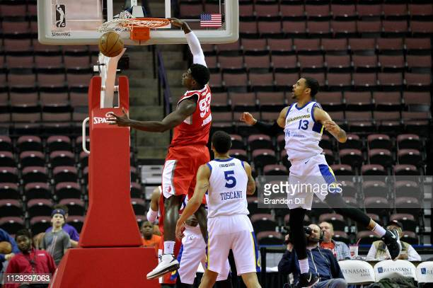 Nino Johnson of the Memphis Hustle dunks the ball ahead of Michael Gbinije of the Santa Cruz Warriors at Landers Center in an NBA GLeague game on...