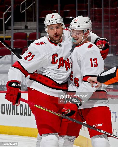 Nino Niederreiter and Warren Foegele of the Carolina Hurricanes celebrate after Foegele scored a goal in the second period against the Chicago...