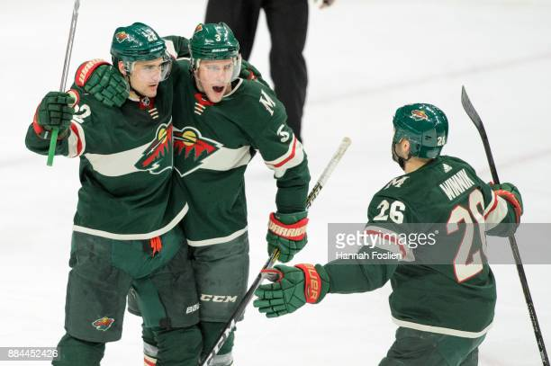 Nino Niederreiter Charlie Coyle and Daniel Winnik of the Minnesota Wild celebrate a goal against the Vegas Golden Knights during the game on November...