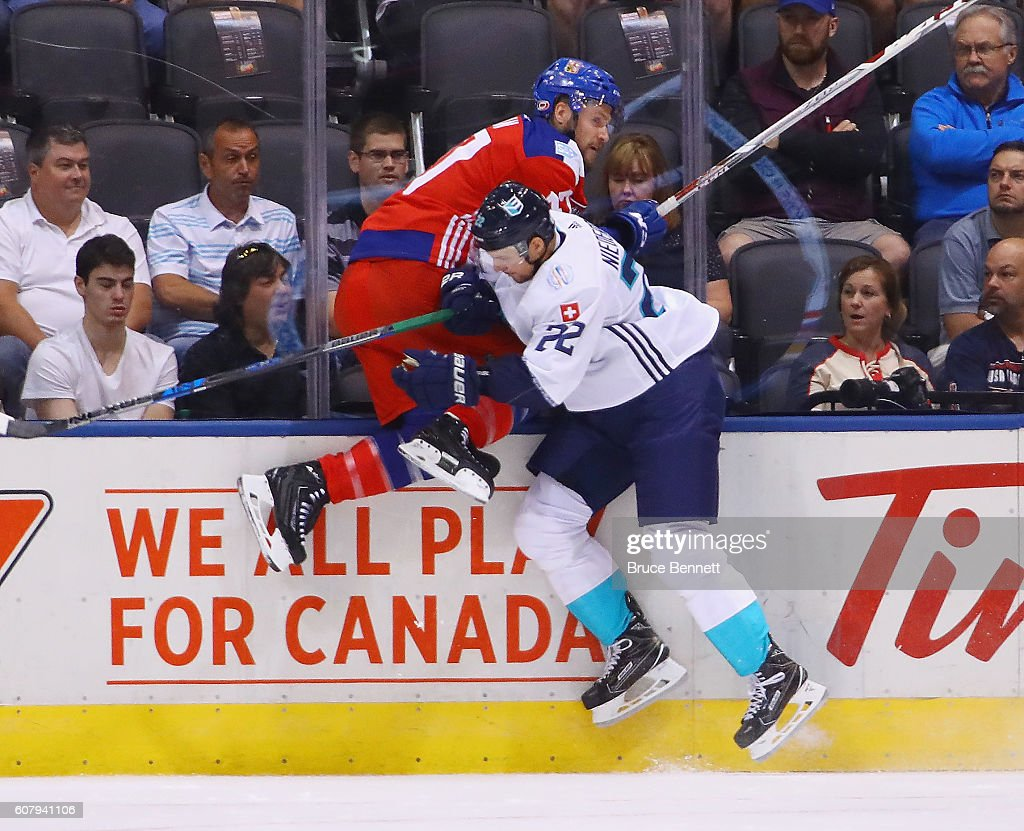 Nino Niederreiter #22 of Team Europe hits Michal Jordan #47 of Team Czech Republic during the first period during the World Cup of Hockey tournament at the Air Canada Centre on September 19, 2016 in Toronto, Canada.