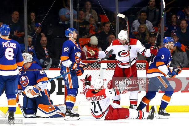 Nino Niederreiter of the Carolina Hurricanes is congratulated by his teammate Jordan Staal after scoring a third period goal as Robin Lehner Brock...