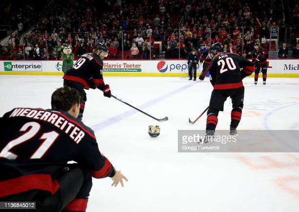 Nino Niederreiter of the Carolina Hurricanes participates in the Storm Surge with teammates Justin Williams Sebastian Aho and Dougie Hamilton after...