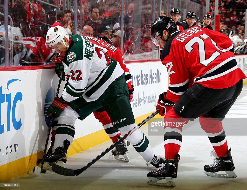 new arrival 9ea37 220d2 Nino Niederreiter of the Minnesota Wild and Eric Gelinas of ...