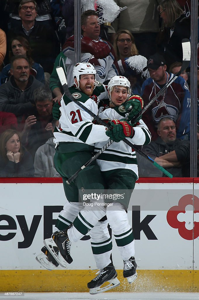 Nino Niederreiter #22 of the Minnesota Wild celebrates his game winning goal with Kyle Brodziak #21 of the Minnesota Wild in overtime against the Colorado Avalanche in Game Seven of the First Round of the 2014 NHL Stanley Cup Playoffs at Pepsi Center on April 30, 2014 in Denver, Colorado. The Wild defeated the Avalanche 5-4 in overtime to win the series.