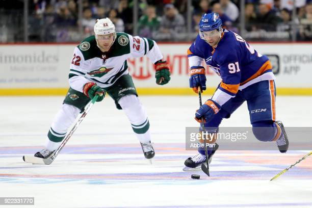 Nino Niederreiter of the Minnesota Wild chases the puck against John Tavares of the New York Islanders in the second period during their game at...