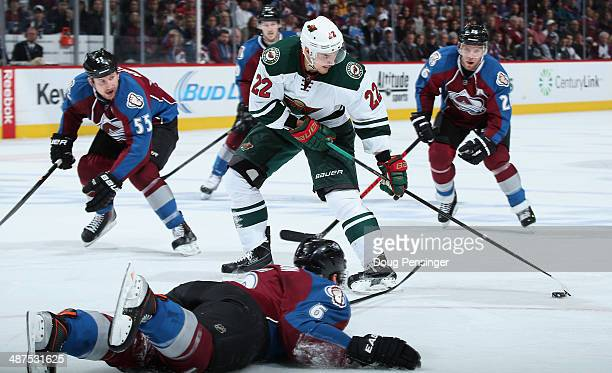 Nino Niederreiter of the Minnesota Wild controls the puck against Cody McLeod Paul Stastny and Erik Johnson of the Colorado Avalanche in Game Seven...