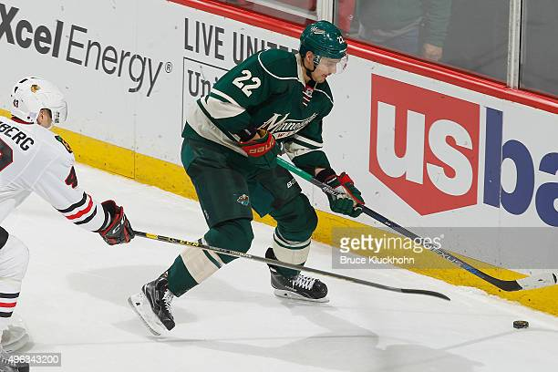 Nino Niederreiter of the Minnesota Wild controls the puck along the boards with Viktor Svedberg of the Chicago Blackhawks defending during the game...