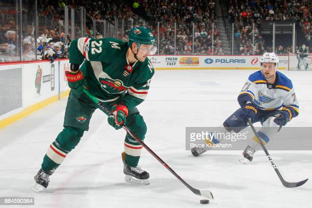 Nino Niederreiter of the Minnesota Wild handles the puck with Vladimir Sobotka of the St Louis Blues defending during the game at the Xcel Energy...