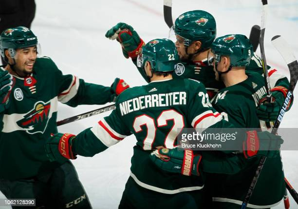 Nino Niederreiter of the Minnesota Wild is congratulated by Mikko Koivu of the Minnesota Wild, Jordan Greenway of the Minnesota Wild and Matt Dumba...