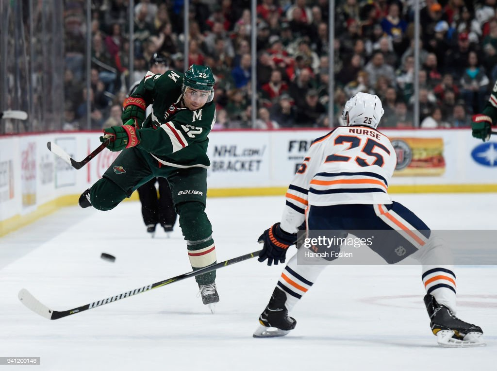 Nino Niederreiter #22 of the Minnesota Wild passes the puck against Darnell Nurse #25 of the Edmonton Oilers during the first period of the game on April 2, 2018 at Xcel Energy Center in St Paul, Minnesota. The Wild defeated the Oilers 3-0.