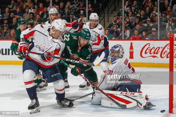 Nino Niederreiter of the Minnesota Wild scores a goal with Dmitry Orlov and goalie Philipp Grubauer of the Washington Capitals defending during the...