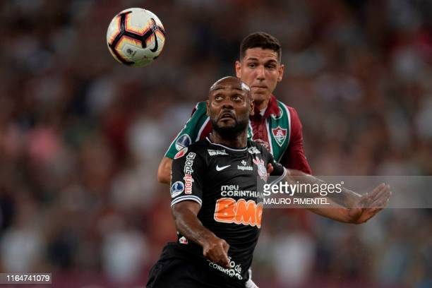 Nino of Brazil's Fluminense vies for the ball with Vagner Love of Brazil's Corinthians during their Copa Sudamericana football match at the Maracana...