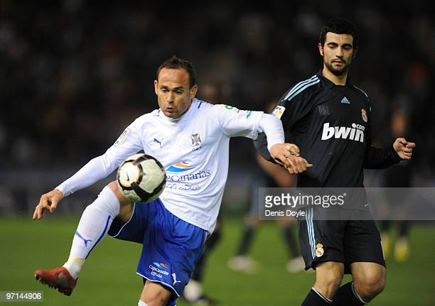 Nino of Tenerife controls the ball beside Raul Albiol of Real Madrid during the La Liga match between Tenerife and Real Madrid at the Heliodoro...