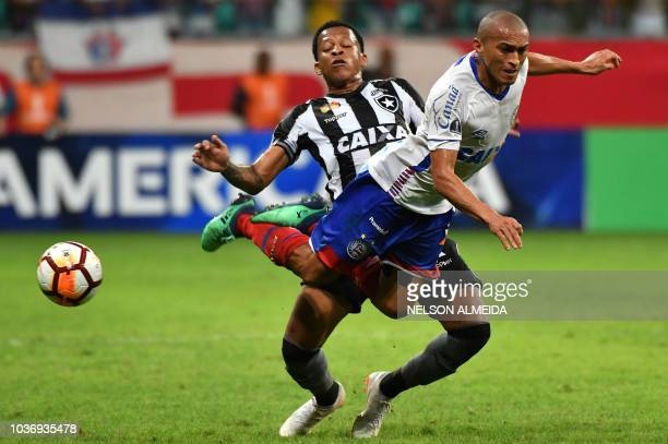 Nino Paraiba of Brazils Bahia vies for the ball with Gustavo Bochecha of Brazil's Botafogo during a 2018 Copa Sudamericana football match at Arena...