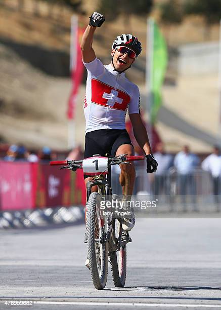 Nino Schurter of Switzerland celebrates as he crosses the line to win gold in the Men's Crosscountry Mountain Bike Cycling during day one of the Baku...