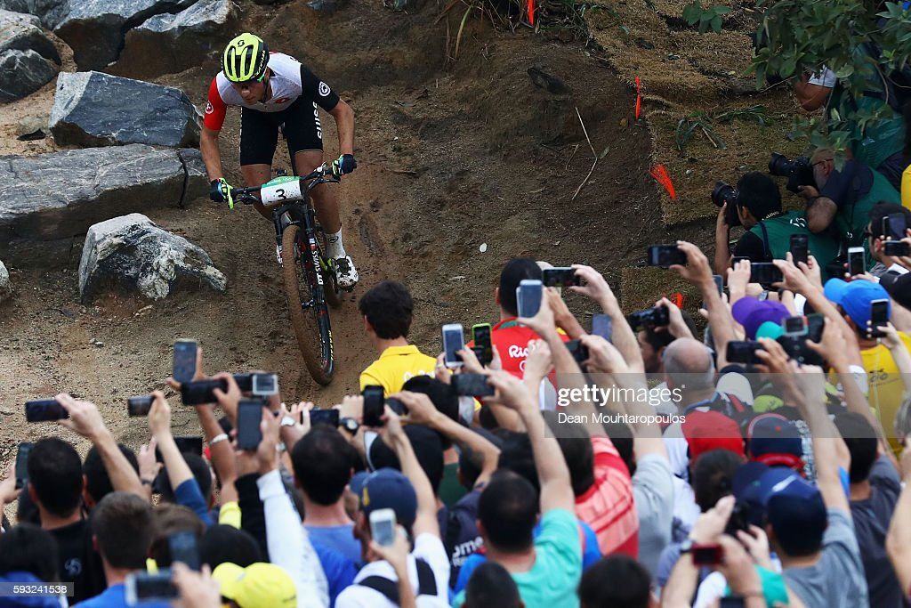 Nino Schurter of Switzerland rides during the Men's Cross-Country on Day 16 of the Rio 2016 Olympic Games at Mountain Bike Centre on August 21, 2016 in Rio de Janeiro, Brazil.