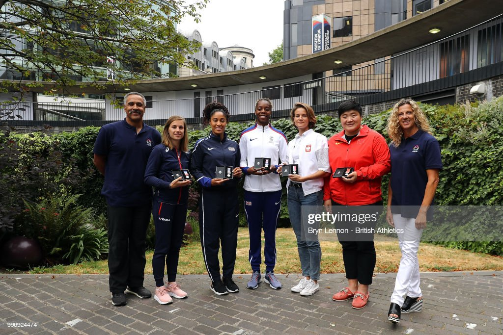 Ninon Guillon-Romarin of France, Queen Harrison of the USA, Lorraine Ugen of Great Britain, Anna Jagaciak-Michalska of Poland and Gong Lijao of China pose for photos at the Athletics World Cup Captains Medal Presentation on July 12, 2018 in London, England. The Athletics World takes place in the London Stadium on the 14th and 15th July.