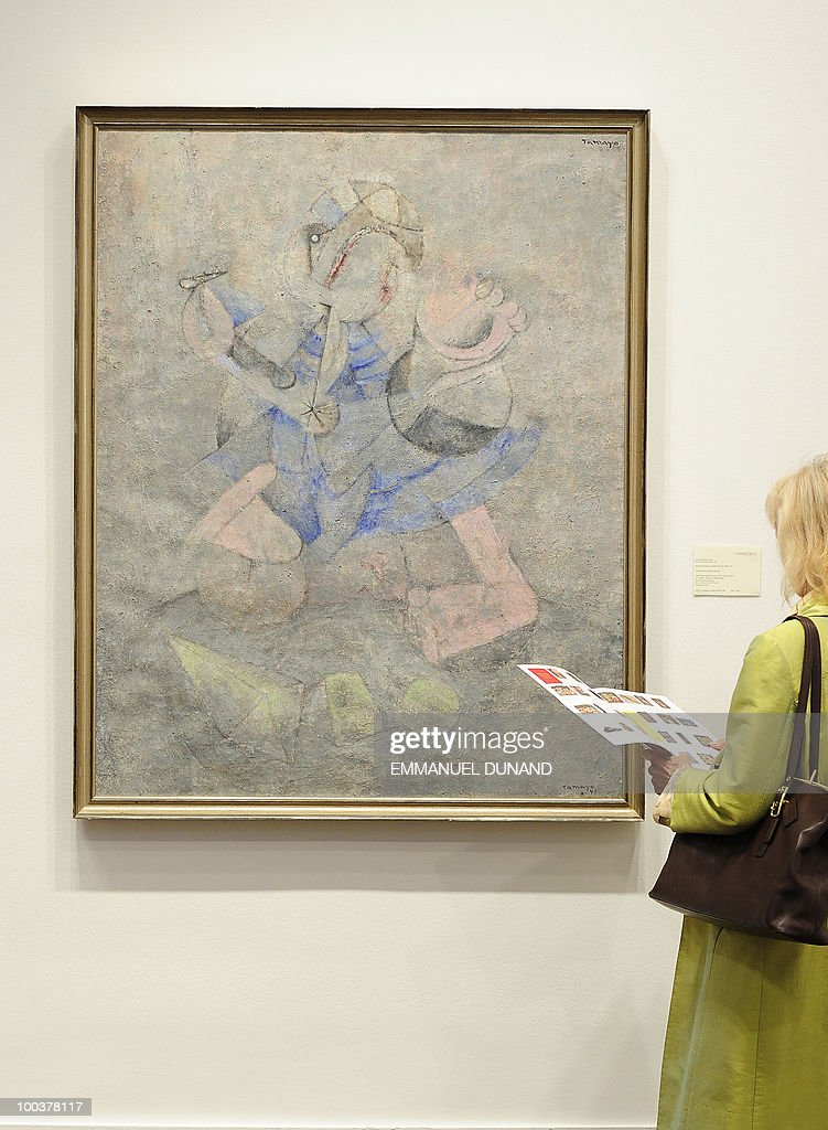 'Ninos Jugando (Child Playing)' by Rufino Tamayo is on display during a preview of Christie's Latin American Art auctions, May 24, 2010 in New York. Christie's will hold its Latin American Art auctions on May 26 and 27, 2010. AFP PHOTO/Emmanuel Dunand