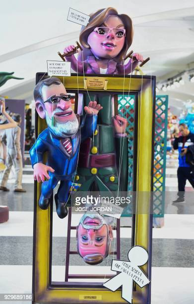 A Ninot a doll depecting a celebrity representing Spain's Primer Ministre Mariano Rajoy Defense minister Maria Dolores de Cospedal and Spanish King...