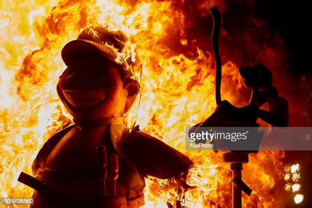 A 'ninot' burns during the last day of the Las Fallas Festival on March 19 2018 in Valencia Spain The Fallas is Valencias most international festival...