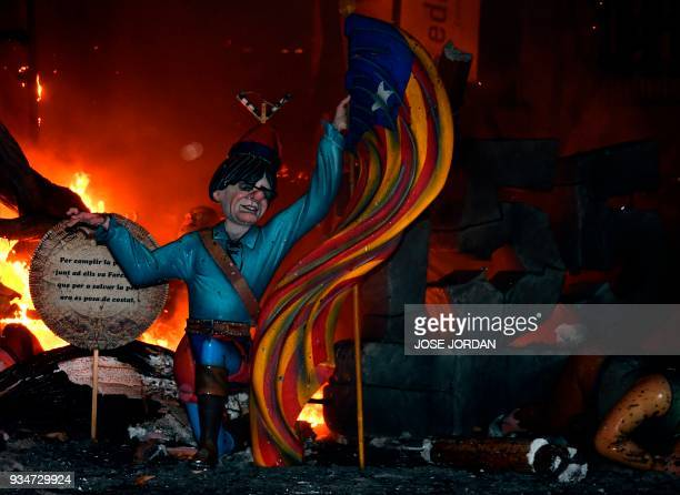 Ninot depicting Catalonia's deposed leader Carles Puigdemont is seen on the last night of the Fallas Festival in Valencia on March 19 2018 Fallas are...