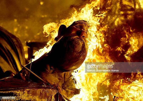 A 'Ninot' depicting Spanish Prime Minister Mariano Rajoy burns during the last day of the Las Fallas Festival on March 19 2015 in Valencia Spain