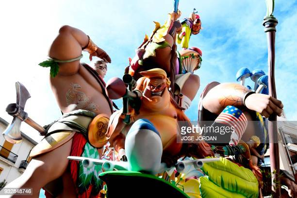 A Ninot of the Falla del Convento de Jerusalen depicting US President Donald Trump is displayed during the Fallas Festival in Valencia on March 16...