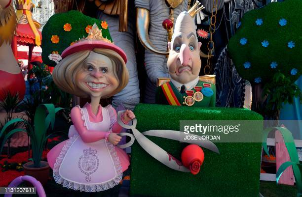 Ninots depicting Spanish former queen and king Sofia and Juan Carlos I are pictured in a falla during the Fallas festival in Valencia on March 17...