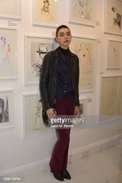 Ninouk Akkerman attends a private view of '100 Women' an exhibition of fashion illustration to celebrate the centenary of women's suffrage at...