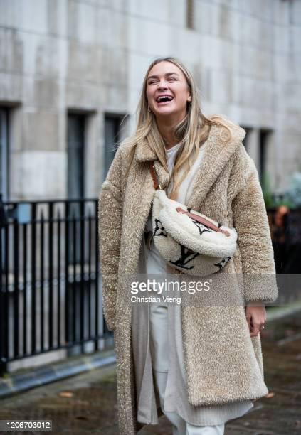 Ninsa Suess seen wearing camel teddy coat, Louis Vuitton fanny bag, white pants outside Preen during London Fashion Week February 2020 on February...